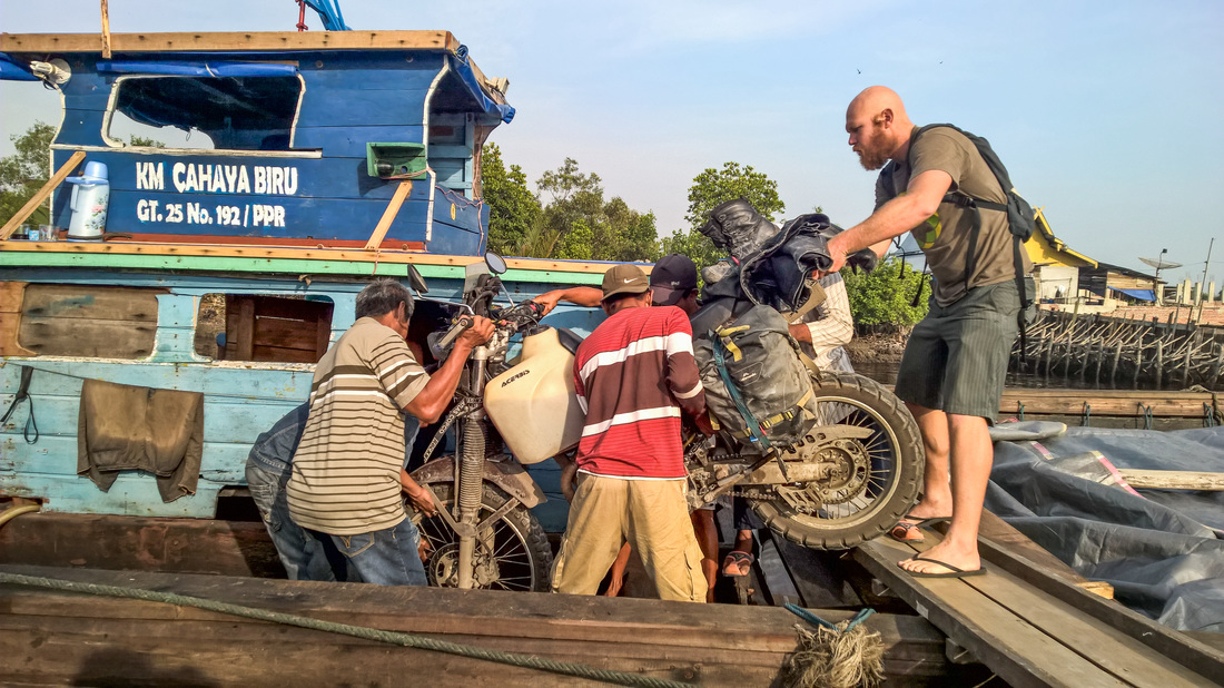Yamaha TTR250 adventure bike being loaded onto a boat