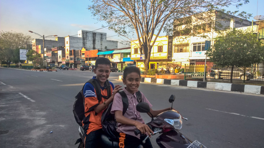 school boys on scooter