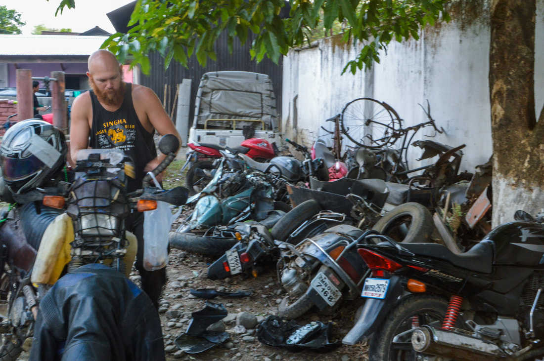 wrecked bikes and scooters piled at an Indian police station